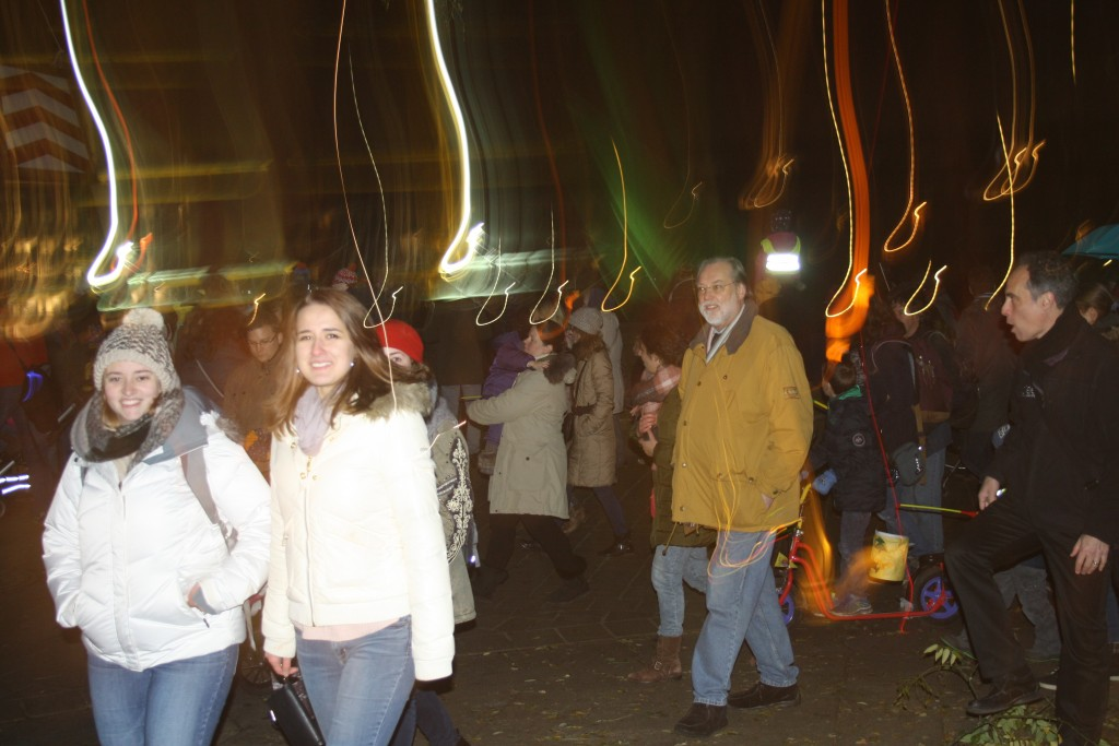 St. Martin`s day - Kate (l.) and Liza (r.) with conference particpiants on lantern walk Lichtermeer