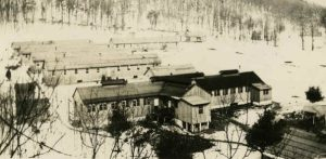 Undated photograph of Camp S-51-PA in the winter. A large building, perhaps the Mess Hall, is in the foreground, and the barracks behind it. Source: http://www.schaeffersite.com/michaux/#CCC