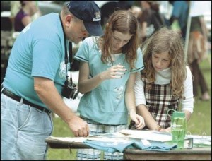 "Paul Garrett, left, talks about the Mechanicsburg Area Environmental Club with Hope Schap and Julia Locy, both 11. They were taking part in the ""Green Festival"" at LeTort Park in Carlisle on Saturday. (Jason Malmont/The Sentinel)"