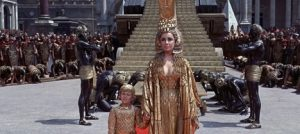 The filmmakers explore various ideas of femininity through Cleopatra's various roles of siren, mother, and queen.