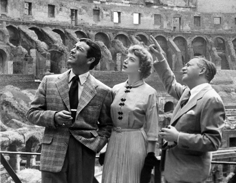 In Rome for the filming of Quo Vadis, Robert Taylor, Deborah Kerr and director Mervyn LeRoy take a tour of the Colosseum