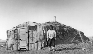 An Inuvialuit person and his home