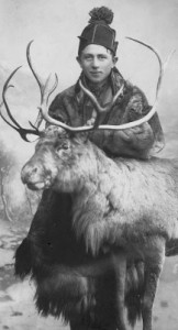 Sami person with a reindeer