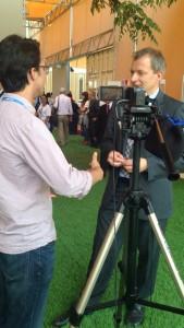 Brady Hummel in the middle of interview Rene Van Berkel, head of UN Industrial Development Program.