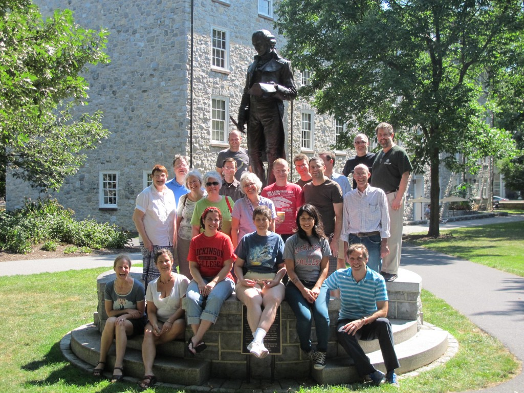 20 Latin teachers surrounding the statue of Benjamin Rush on the campus of Dickinson College