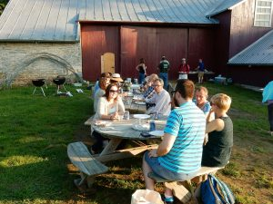 Conventiculum participants enjoying dinner at the Dickinson Organic Farm