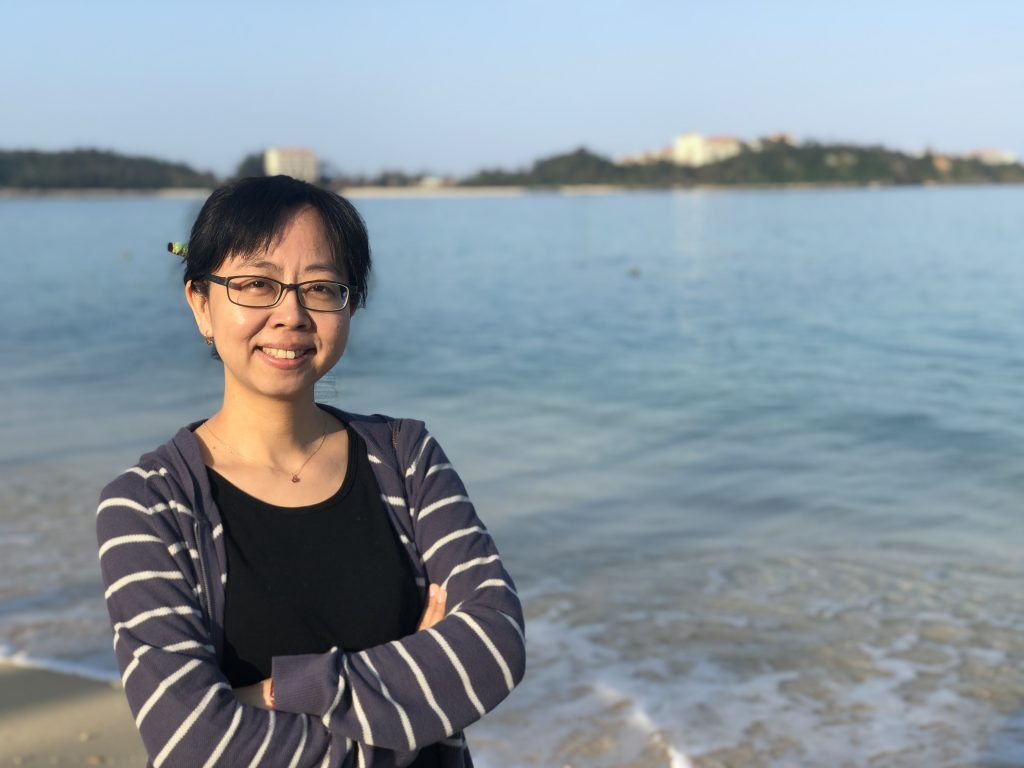 photo of Chun Liu outside at some kind of lake