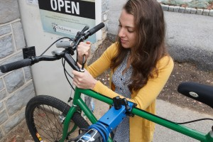 Avery McGuire '13, former Handlebar Manager, works on Glen's Green Bike