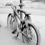 Bike covered in snow.
