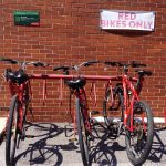 Red bikes that can be rented at Dickinson Public Safety in the back entrance of Kaufman Hall.
