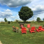 Red adirondack chairs at Dickinson Farm.
