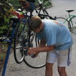 Rob '19 fixing his bike at the Handlebar.