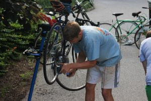 Rob Paige '17 fixing his bike at The Handlebar.
