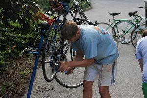 Rob Paige '17 fixing his bike at The Handlebar.