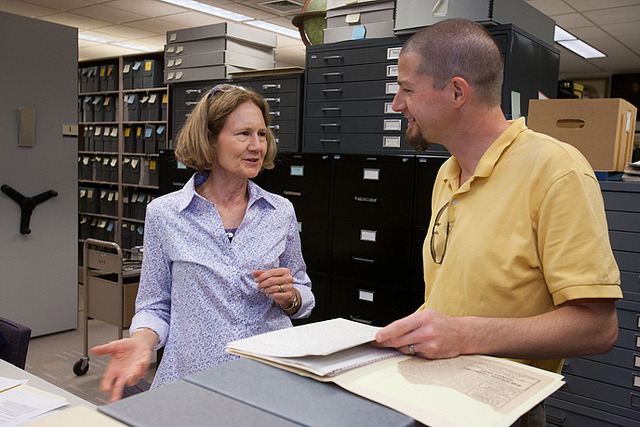 Gail Troussoff Marks ('73) and Karl Qualls, associate professor of history at Dickinson College, look over documents that Marks has contributed to the Dickinson archives. source: Dickinson College flickr http://bit.ly/16UZXd0
