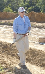 President Durden volunteered to help dig at the farm.