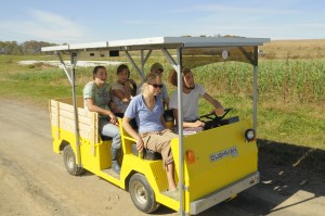 Student workers zip around the farm on our Solar Wheeler, a solar-powered golf cart.