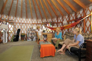 Dickinson Farm Interns and student workers relax inside one of their yurts.