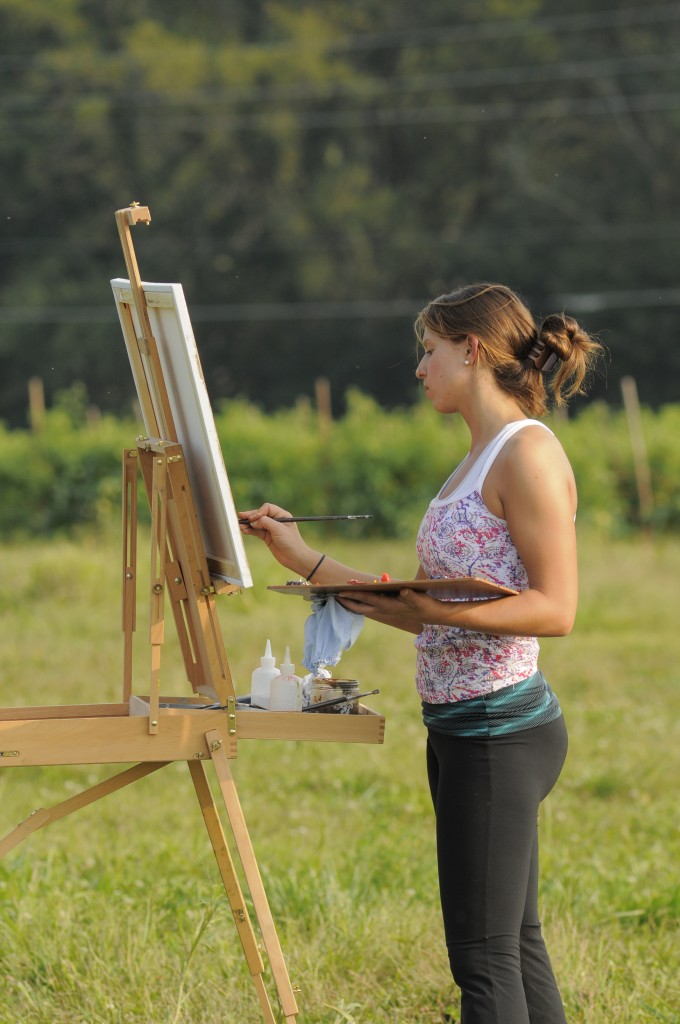 A painting student with her canvas at Dickinson Farm.