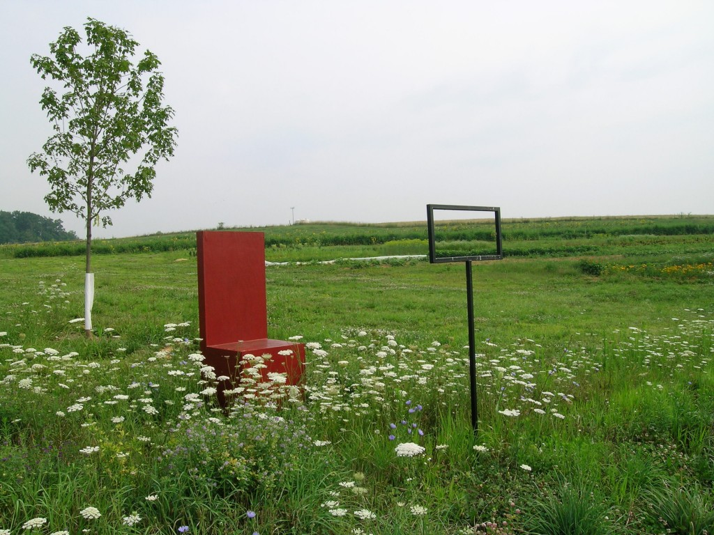 An art installation at Dickinson Farm: Chair with a view of the Lower Barn.
