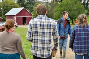 Scott Hoffman '12 gives a farm tour in 2011.