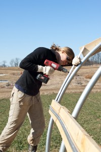 Claire Fox '11 helps construct one of the farm's greenhouses.