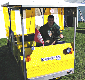 Sam Wheeler and the solar-powered Cushman golf cart he built with Matt Steiman for an independent research project.