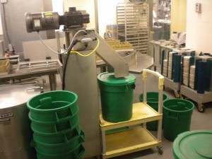 Dickinson Dining Hall's food pulper packs food waste into green bins.