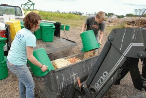 Dickinson Farm Student Volunteers Dump Compost Waste for Incorporation into a Compost Pile