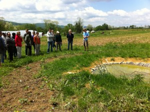 "Scott Hoffman explains his experimental ""biodiversity hubs"" to a tour group from Harrisburg Area Community College.."