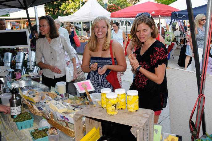 Dickinson Students shop for cheese at Farmers on the Square.