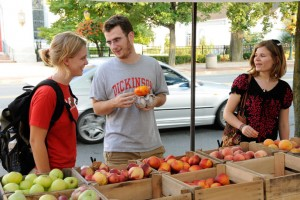 Students shop at the weekly Farmers on the Square market.