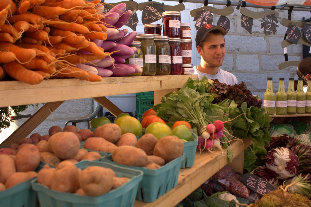 "Daniel Grover. ""Farmers on the Square"" market, Dickinson College produce stand, downtown Carlisle."