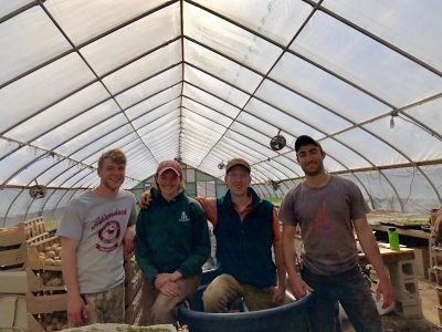 Rob (far left) with Madison Beehler '15 (left) and Brendan Murtha '14 (far right) at The Food Project