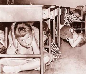 "Students demonstrating ""Duck and Cover"" Circa 1950. Photo Credit: http://undergroundbombshelter.com/news/w…."