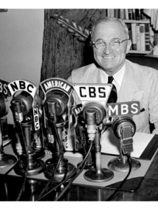 Truman in front of multiple radio microphones (Courtesy of Time Magazine)