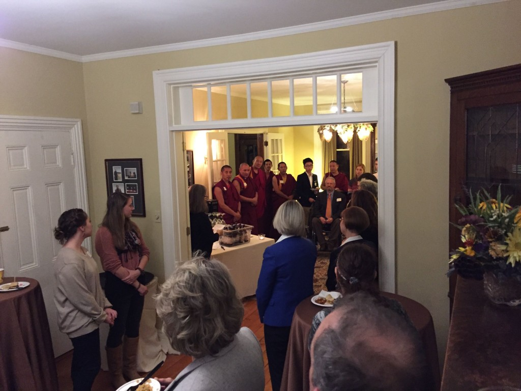 Director of the Clark Forum and Prof. of American Studies Amy Farrell welcomes the monks to a reception with students, staff, and faculty.