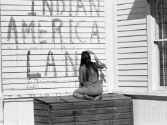 This photograph taken in November of 1969 of an activist painting a sign on the island.
