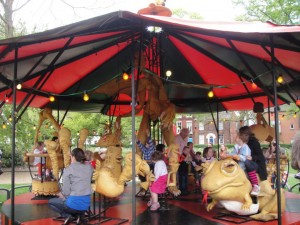 Slightly creepy interactive wooden carousel