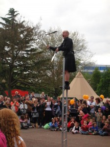 Pete Dobbing juggling machetes on a ladder