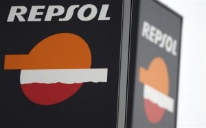 The logo of Spanish oil major Repsol is seen outside a petrol station in Madrid