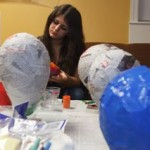 student participate in special day of the dead piñata making