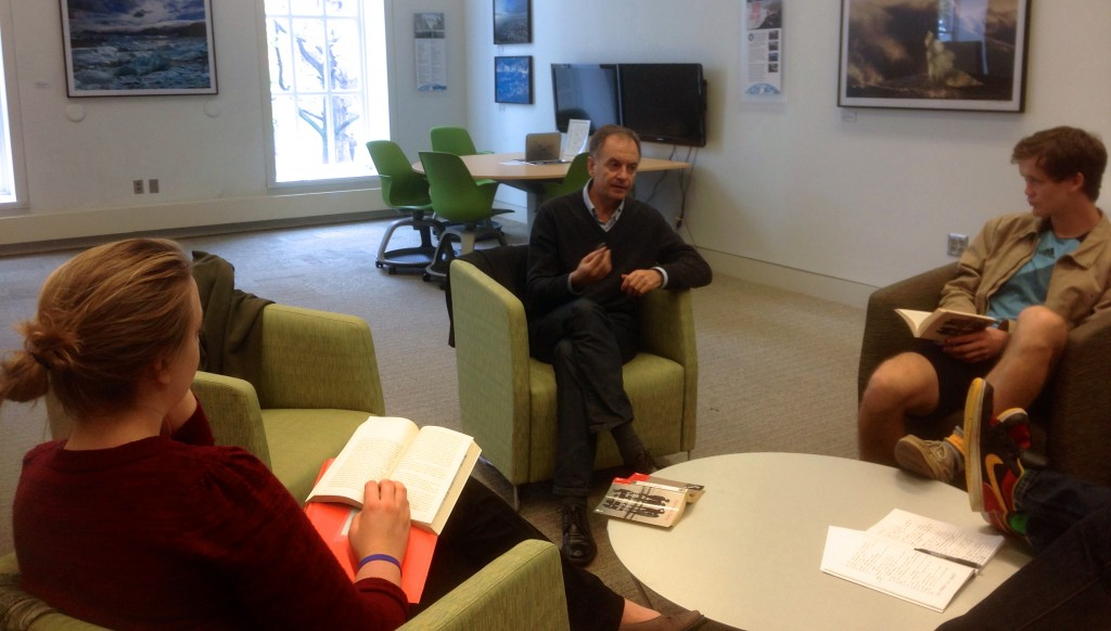 Antonio Soler, center, works with students from Prof. Aldrich's Spanish 340 class.