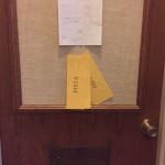 Clues were placed on the professor's door.