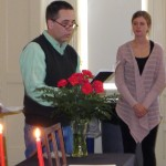 Professor Aldrich reads a poem to inductees