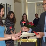 Professor Brito receives a carnation and certificate