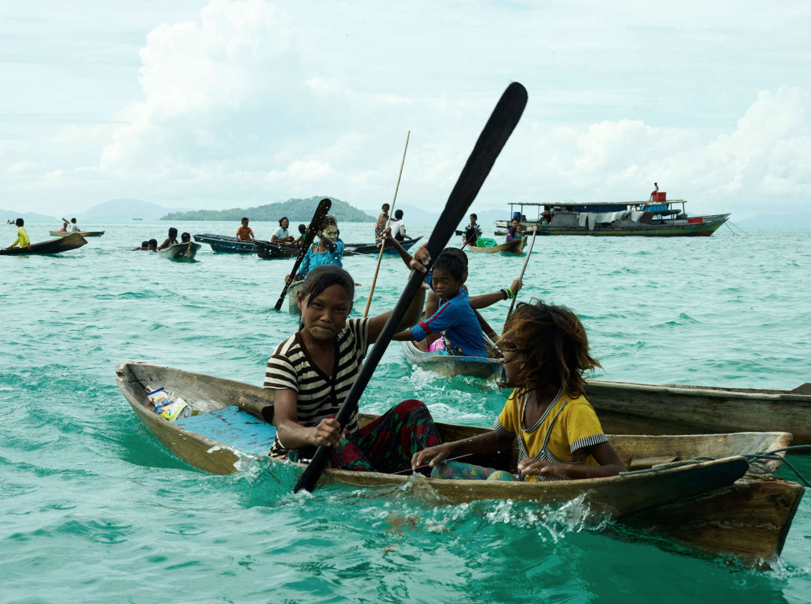 Bajau Children Row Boat