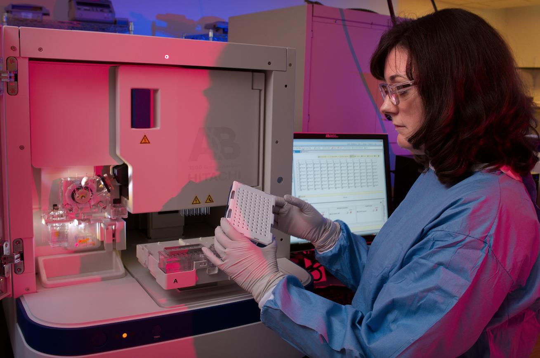 woman performing genetic test