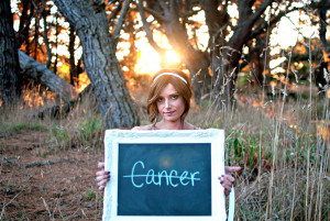 cancer free sign being held by a woman