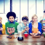 35328294-Diverse-People-Digital-Devices-Wireless-Communication-Concept-Stock-Photo